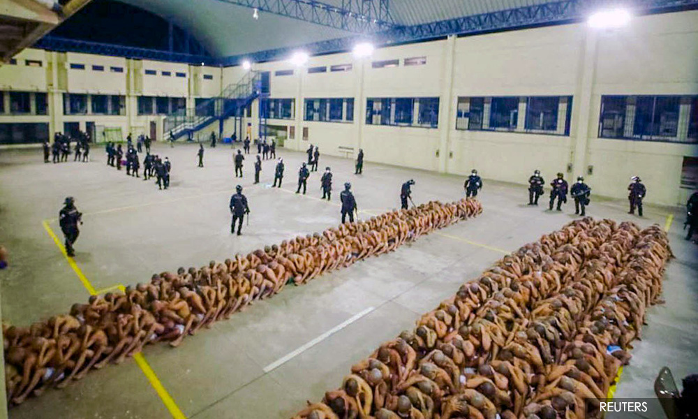 El Salvador lines up semi-naked gang members for grim
